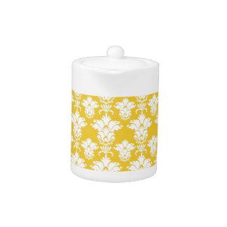 暗い黄色のエレガントで白いダマスク織パターン