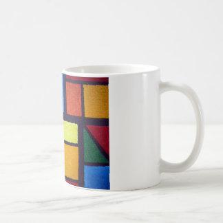 曖昧なモンドリアンの緑およびオレンジパターン コーヒーマグカップ