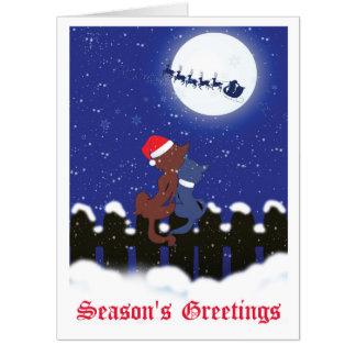 月の巨大な挨拶状を見ているクリスマス猫 カード