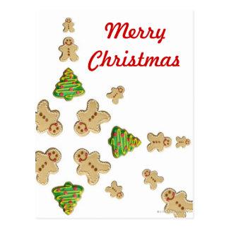 木およびジンジャーブレッドマンのクッキーの雪片 ポストカード