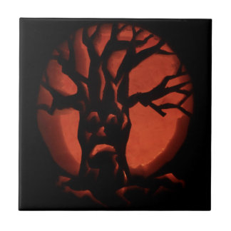 木のハロウィンの白熱おびえさせていた死んだカボチャ タイル