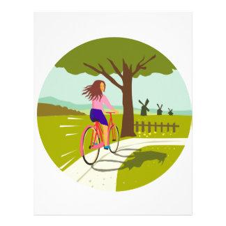木の円のレトロの上の女の子の乗馬の自転車 レターヘッド