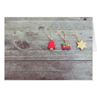 木の装身具のクリスマスの挨拶状 カード