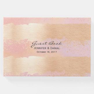 来客名簿を結婚しているピンクおよび金ゴールドのブラシの打撃 ゲストブック