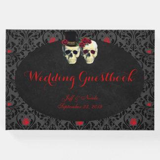 来客名簿を結婚する赤い花嫁の新郎のスカル ゲストブック