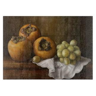 柿およびブドウのペンキが付いているクラシックな静物画 カッティングボード
