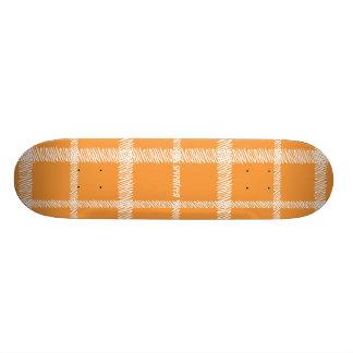 格子縞のオレンジ スケートボード