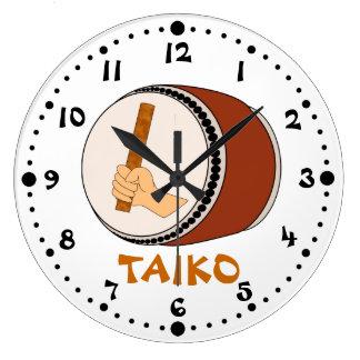 棒のTaikoのドラム日本のなドラムをたたくことを保持する手 ラージ壁時計