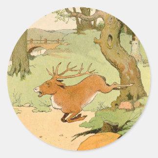 森林のオジロ鹿シカの雄鹿のランニング ラウンドシール