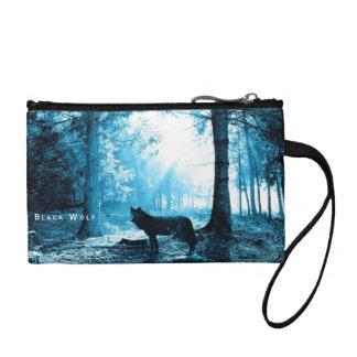 森林の単独で黒いオオカミ コインパース