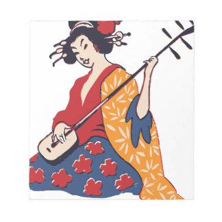 楽器を演奏している芸者 ノートパッド