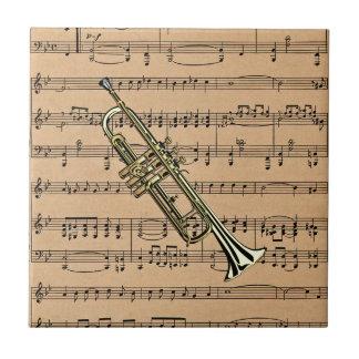 楽譜の背景が付いているトランペット タイル