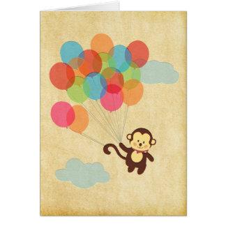 気球と遠くにな愛らしい猿飛行 グリーティングカード