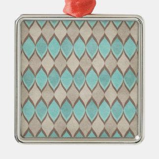 水のティール(緑がかった色)の素朴な道化師の幾何学的なプリント メタルオーナメント