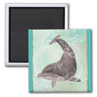 水の緑水ではねかけているイルカ マグネット