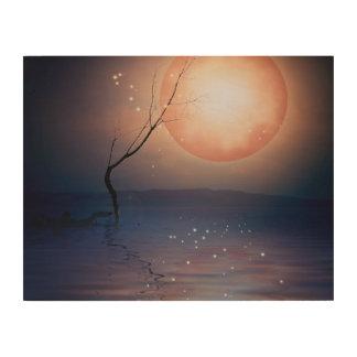 水上のピンクおよび青いファンタジーの光っている月 ウッドウォールアート