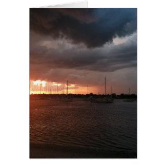 水写真の日没そしてボート カード