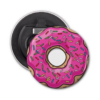 水分が多くおいしいピンクによって振りかけられるドーナツ 栓抜き