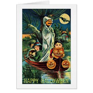 泥地の幽霊のカボチャヴィンテージハロウィン グリーティングカード