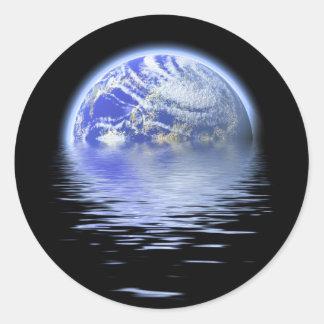 洪水の水のさざ波上の地球 ラウンドシール