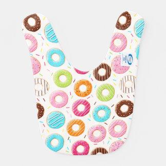 活発で多彩なドーナツはトッピングパターンを振りかけます ベビービブ