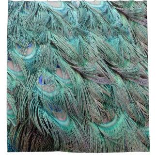 流れる緑の羽によって隠される青い目 シャワーカーテン
