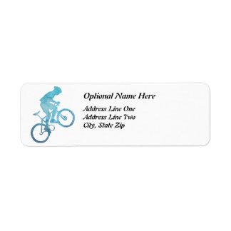 涼しく青いバイクもしくは自転車に乗る人 ラベル