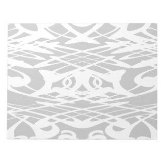 淡い色のな灰色のアールヌーボーのスタイルパターンおよび白い ノートパッド