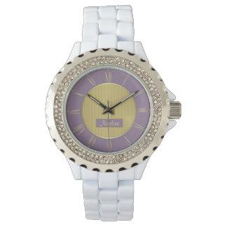 淡い色のな紫色および金ゴールド 腕時計