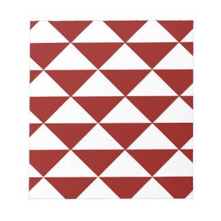 深紅色および白い三角形 ノートパッド