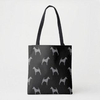 滑らかなフォックステリア犬はパターンのシルエットを描きます トートバッグ