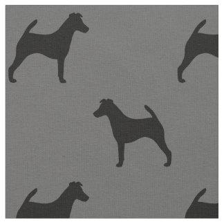 滑らかなフォックステリア犬はパターンのシルエットを描きます ファブリック