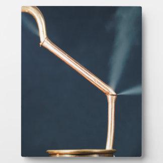 漏出および蒸気が付いている銅の管 フォトプラーク