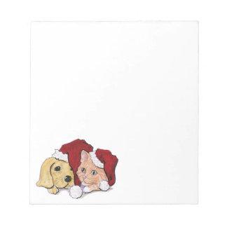 漫画のクリスマス、サンタの帽子のかわいい子犬の子ネコ ノートパッド