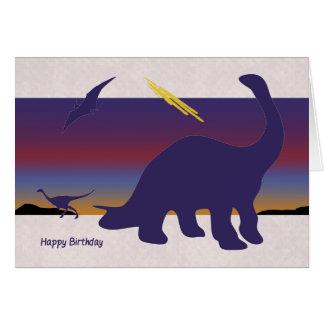 激しい日没のバースデー・カードを持つシルエットの恐竜 カード