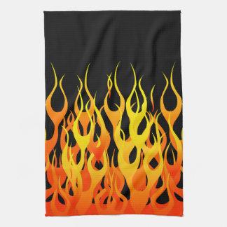火の炎を競争させているクラシックなオレンジ キッチンタオル