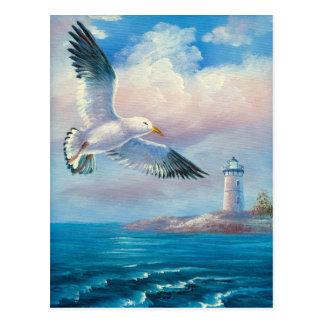 灯台の近くで飛んでいるカモメの絵画 ポストカード