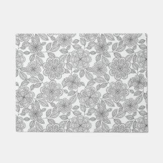 灰色およびクリーム色の花柄 ドアマット