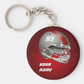 灰色および赤いフットボール用ヘルメット ベーシック丸型缶キーホルダー