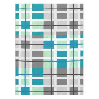 灰色の真新しいティール(緑がかった色)の白く幾何学的なテーブルクロス テーブルクロス