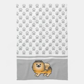 灰色の足パターンとのオレンジクロテンのポメラニア犬 キッチンタオル