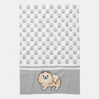 灰色の足パターンとのクリーム色のポメラニア犬 キッチンタオル