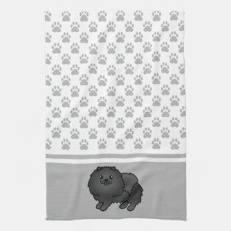 灰色の足パターンとの黒いコートのポメラニア犬 キッチンタオル