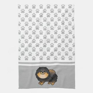 灰色の足パターンとの黒そしてタンのポメラニア犬 キッチンタオル