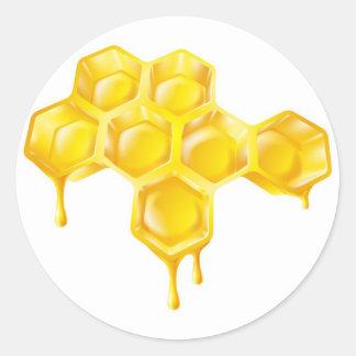 点滴注入の蜂蜜が付いている蜜蜂の巣 ラウンドシール
