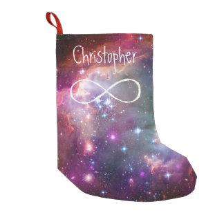 無限ループおよび銀河系の宇宙のヒップスターの背景 スモールクリスマスストッキング