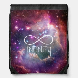 無限ループおよび銀河系の宇宙のヒップスターの背景 ナップサック