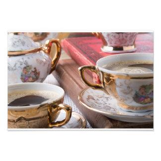 熱いエスプレッソが付いているヴィンテージのコーヒーカップおよびレトロ フォトプリント