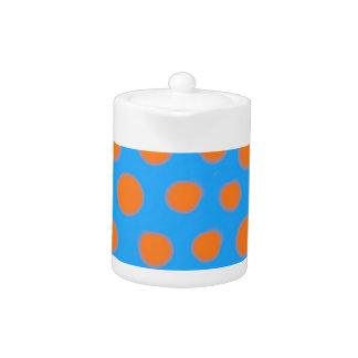 熱いオレンジおよび青の水玉模様の水彩画