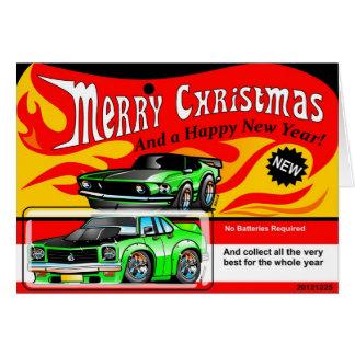 熱い筋肉車のおもちゃのメリークリスマスの明けましておめでとう グリーティングカード